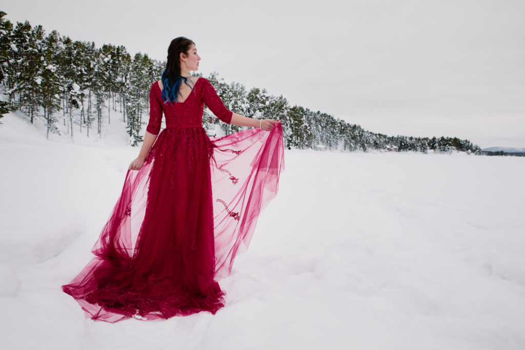 wedding red dress snow lapland